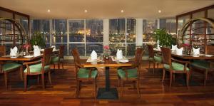 مطعم أو مكان آخر لتناول الطعام في جولدن تيوليب للشقق الفندقية