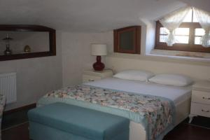 A bed or beds in a room at Hotel Casa Villa