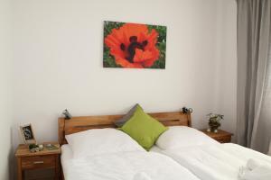 Ein Bett oder Betten in einem Zimmer der Unterkunft Der Teichhof
