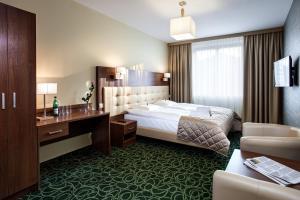 Łóżko lub łóżka w pokoju w obiekcie Hotel Royal Botanic