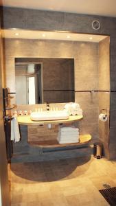 A bathroom at ApartHotel Sainte-Marthe
