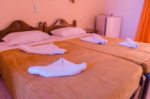 A bed or beds in a room at Anatoli Beach Hotel