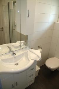 Ein Badezimmer in der Unterkunft Hotel Lu