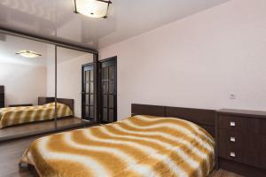 Кровать или кровати в номере Марьин Дом на Свердлова, 2