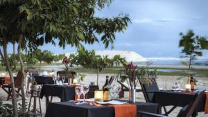 A restaurant or other place to eat at Blue Residence Hotel