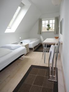 En eller flere senge i et værelse på Kongsgård Bed & Breakfast