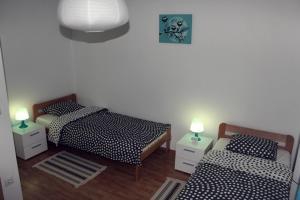 Postel nebo postele na pokoji v ubytování Apartment Elena
