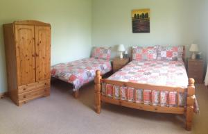 A bed or beds in a room at Amber B&B