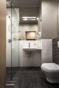 Vonios kambarys apgyvendinimo įstaigoje Hotel Zatoka