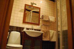 A bathroom at Apartment Stepana Bandery Street