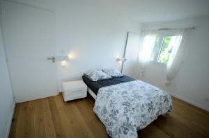 Un ou plusieurs lits dans un hébergement de l'établissement Appartement chemin du Paret