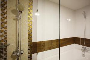 A bathroom at Orchid Resortel