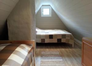 Voodi või voodid majutusasutuse Lohusalu Apartment toas