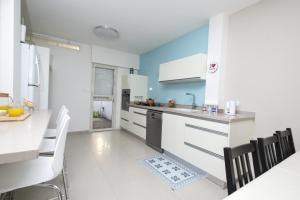 A kitchen or kitchenette at Eshkol Housing Haifa - Luxury Villa Panoramic Sea View