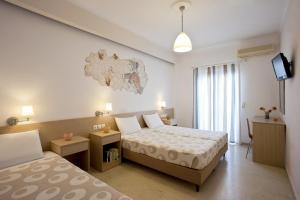 Ένα ή περισσότερα κρεβάτια σε δωμάτιο στο Ξενοδοχείο Ιππόκαμπος