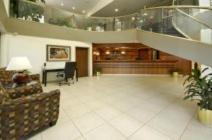 The lobby or reception area at Ramada by Wyndham Bettendorf