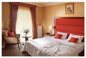 Кровать или кровати в номере Отель Баташев