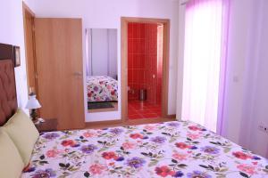 Uma cama ou camas num quarto em Nascente do Côa Turismo Rural