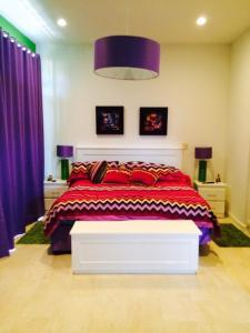 A bed or beds in a room at Casa Los Sueños