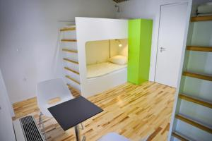 A bunk bed or bunk beds in a room at Youth Hostel Ajdovscina
