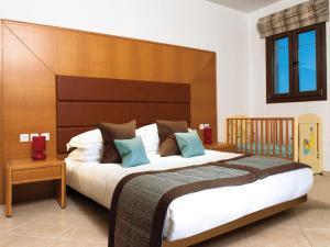 מיטה או מיטות בחדר ב-Dolce Vati Luxury Villas