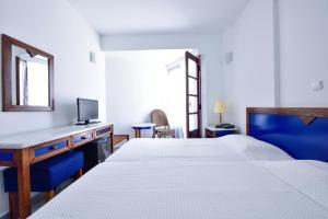 Łóżko lub łóżka w pokoju w obiekcie Kalidon Hotel