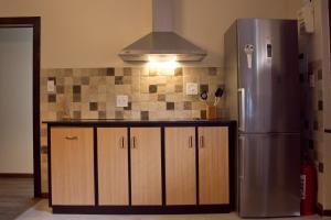 A kitchen or kitchenette at Bakgat Blyplek