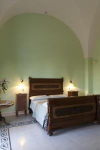 A bed or beds in a room at Villa Urso bed&breakfast