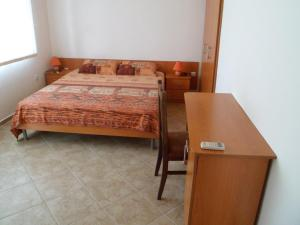 A bed or beds in a room at Holiday Home Okka By