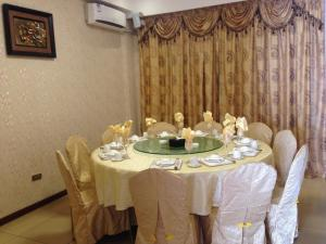A restaurant or other place to eat at Hotel Grand Ami