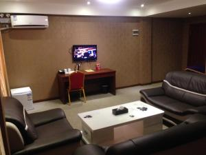 A television and/or entertainment center at Hotel Grand Ami