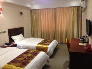 A bed or beds in a room at Hotel Grand Ami