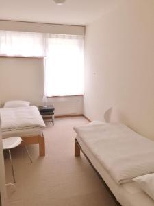 Ein Bett oder Betten in einem Zimmer der Unterkunft Ferienwohnungen Fontana