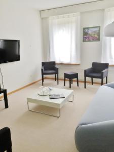 Ein Sitzbereich in der Unterkunft Ferienwohnungen Fontana
