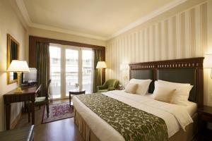 מיטה או מיטות בחדר ב-Electra Hotel Athens