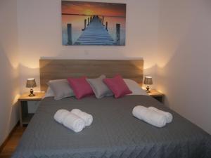 Krevet ili kreveti u jedinici u objektu Momentum Apartment