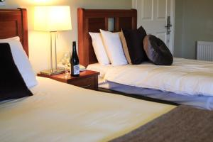A bed or beds in a room at McGrory's Hotel