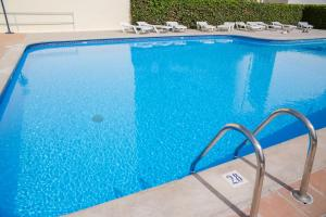 The swimming pool at or near Hostal Sunset Ibiza