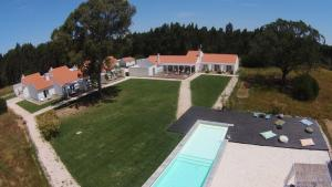 A view of the pool at Casas da Lupa or nearby