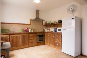 A kitchen or kitchenette at Casa da Pedra
