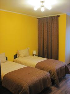 Кровать или кровати в номере Апартаменты Знатный Гость