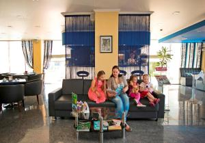 A family staying at Krasnodar Aerohotel