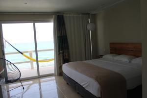 Кровать или кровати в номере Rocamar Hotel Isla Mujeres