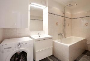 A bathroom at Apartment Pštrossova