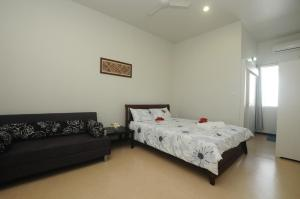 A bed or beds in a room at Talofa Inn