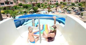 Вид на бассейн в Rehana Sharm Resort - Aquapark & Spa - Couples and Family Only или окрестностях