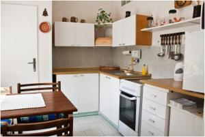 Kuchyň nebo kuchyňský kout v ubytování Privat No. 40