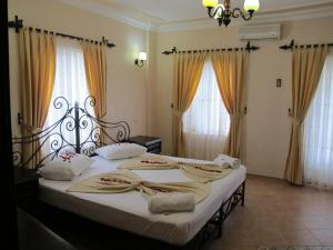 A bed or beds in a room at Anatolia Resort