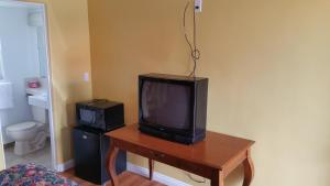 A television and/or entertainment center at Slumber Motel
