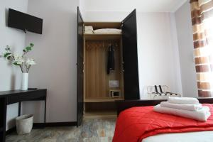 A bed or beds in a room at MilanoRooms Bacone